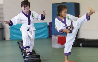Young boy and girl training in a martial arts class